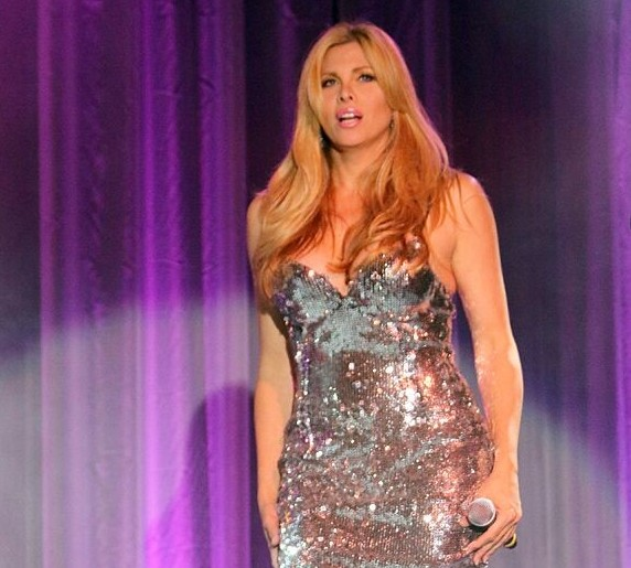 Candis Cayne costumes were the unbilled star of the night